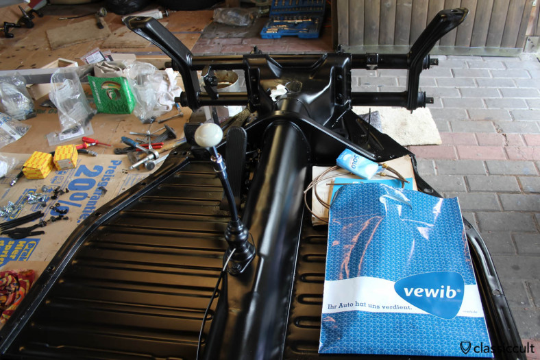 VW Beetle restoration assembling the floor pan with restored, nos and new parts.