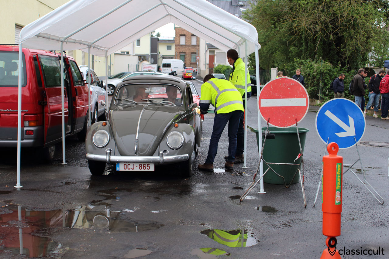 VW Ragtop Beetle with huge rear window, from Belgium and searching for car park.