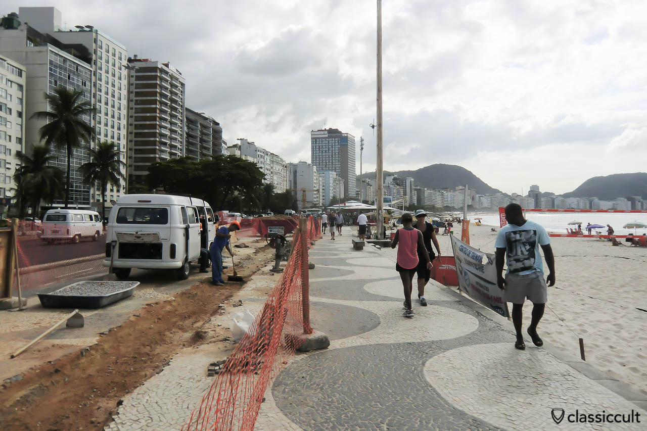 Brazilian VW Kombi Bus at Copacabana Promenade, Rio, Brazil, May 22, 2013. The construction workers are repairing the nice Copacabana beach wave pattern promenade.