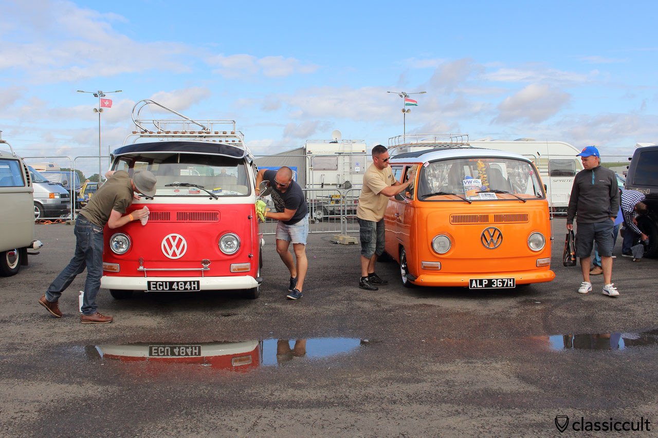 T2 Bus polishing at Bug Jam VW Fest 2015, nice mirror effect in rain puddle