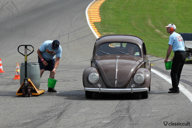 Race VW Split Bug getting prepared with water for drag racing burnout.