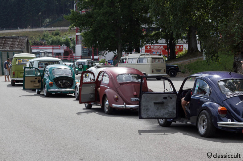 VW Beetles with open doors on the way to the big parade.