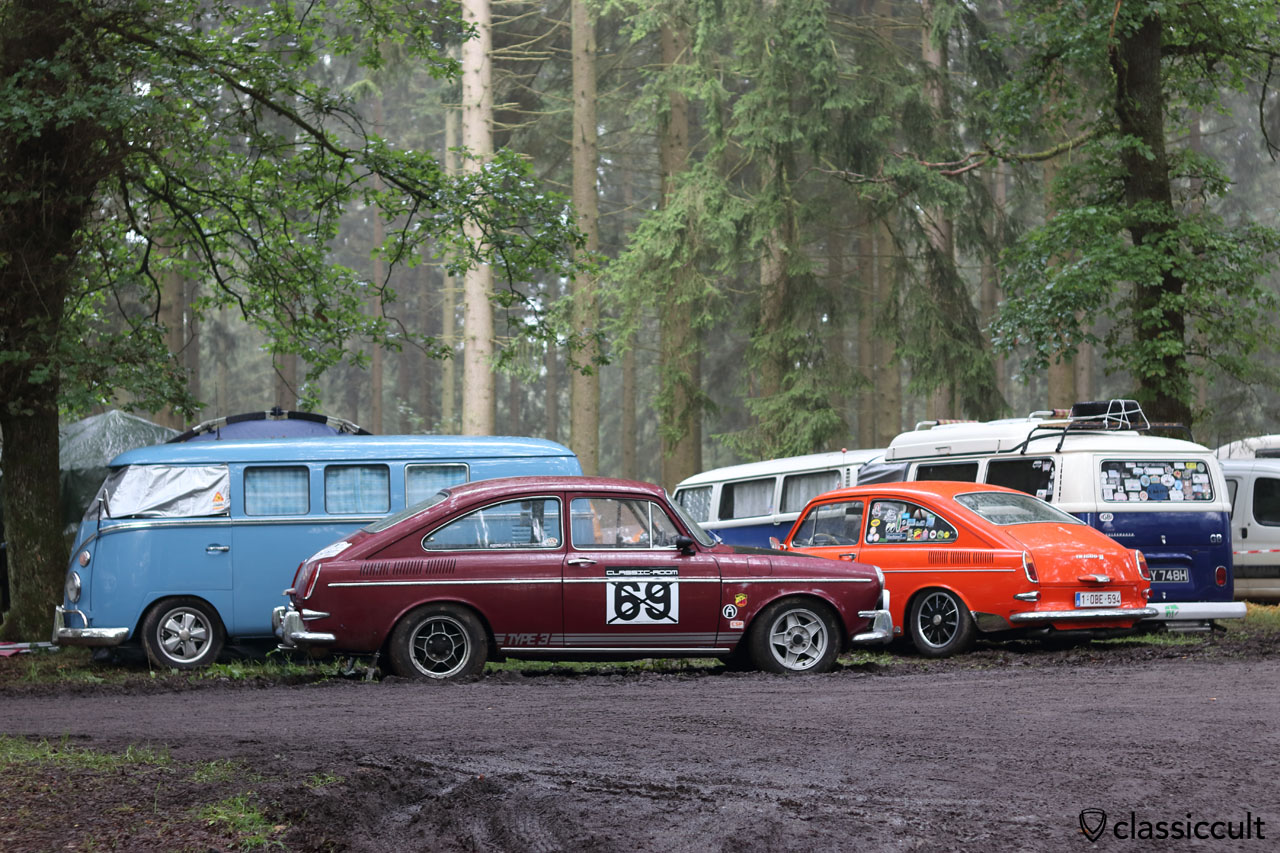 red and orange VW Type 3 fastback deep in the forest around the Spa Racetrack
