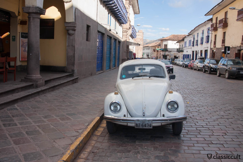 Classic VW Beetles in the city center of Cuzco, Peru, May 11, 2013. The second beetle is parking on the right hand side of the road.