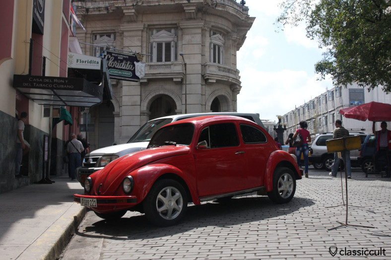 Classic VW Beetle parking at The Floridita, Ernest Hemingway's favorite bar in Havana Cuba. March 28, 2014