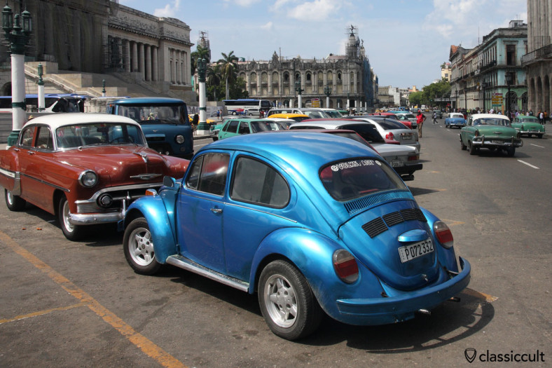 Classic VW Beetle at El Capitolio Havana between American classic cars and the Gran Teatro de La Habana. March 29, 2014