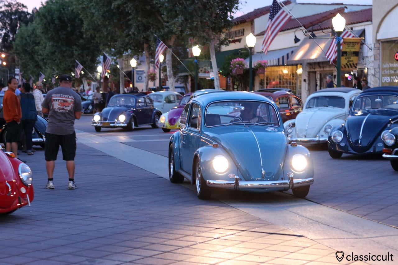 blue VW Beetle cruising home