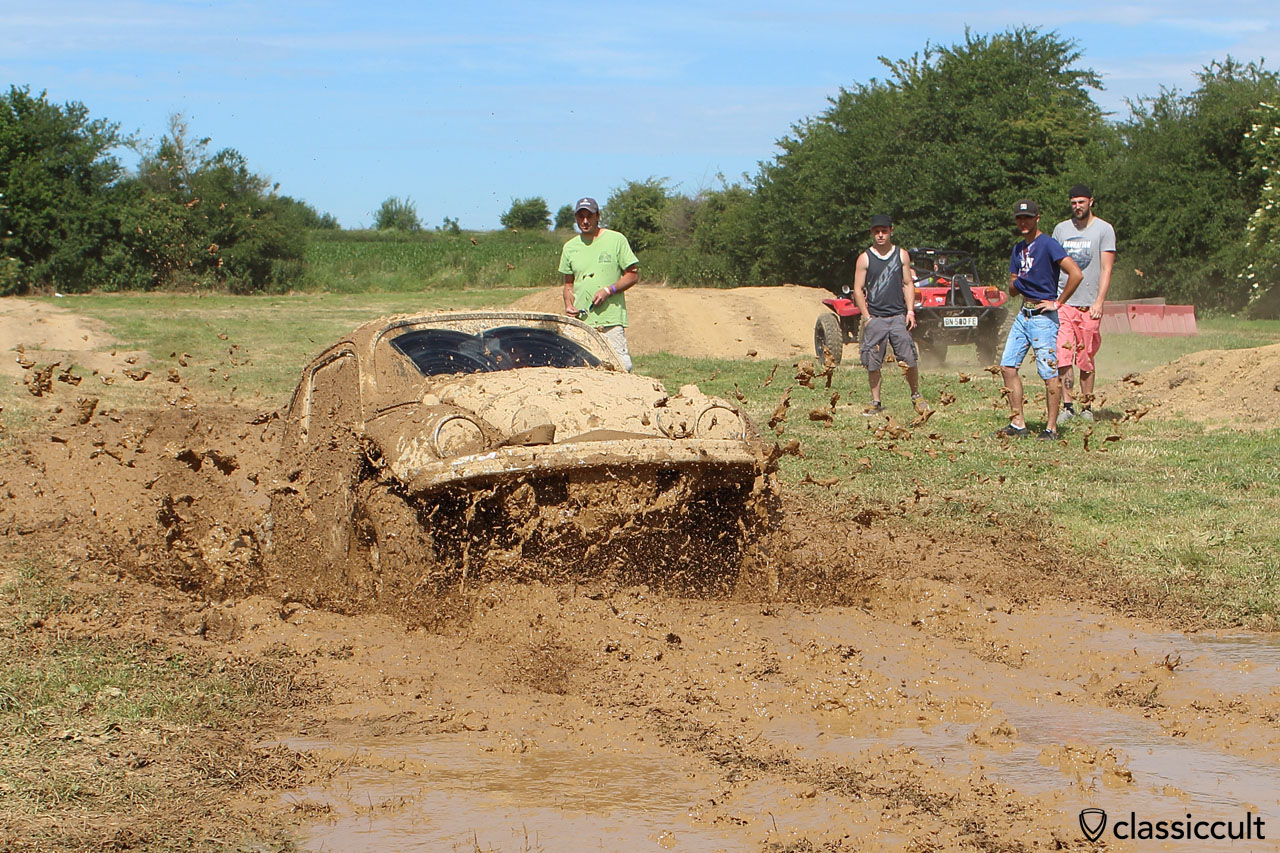 VW Off-Road Beetle makes the way through a deep mud hole