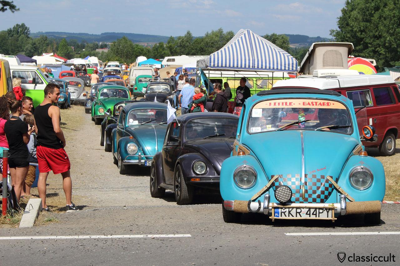 low VW Beetle drives off to Wawel Castle