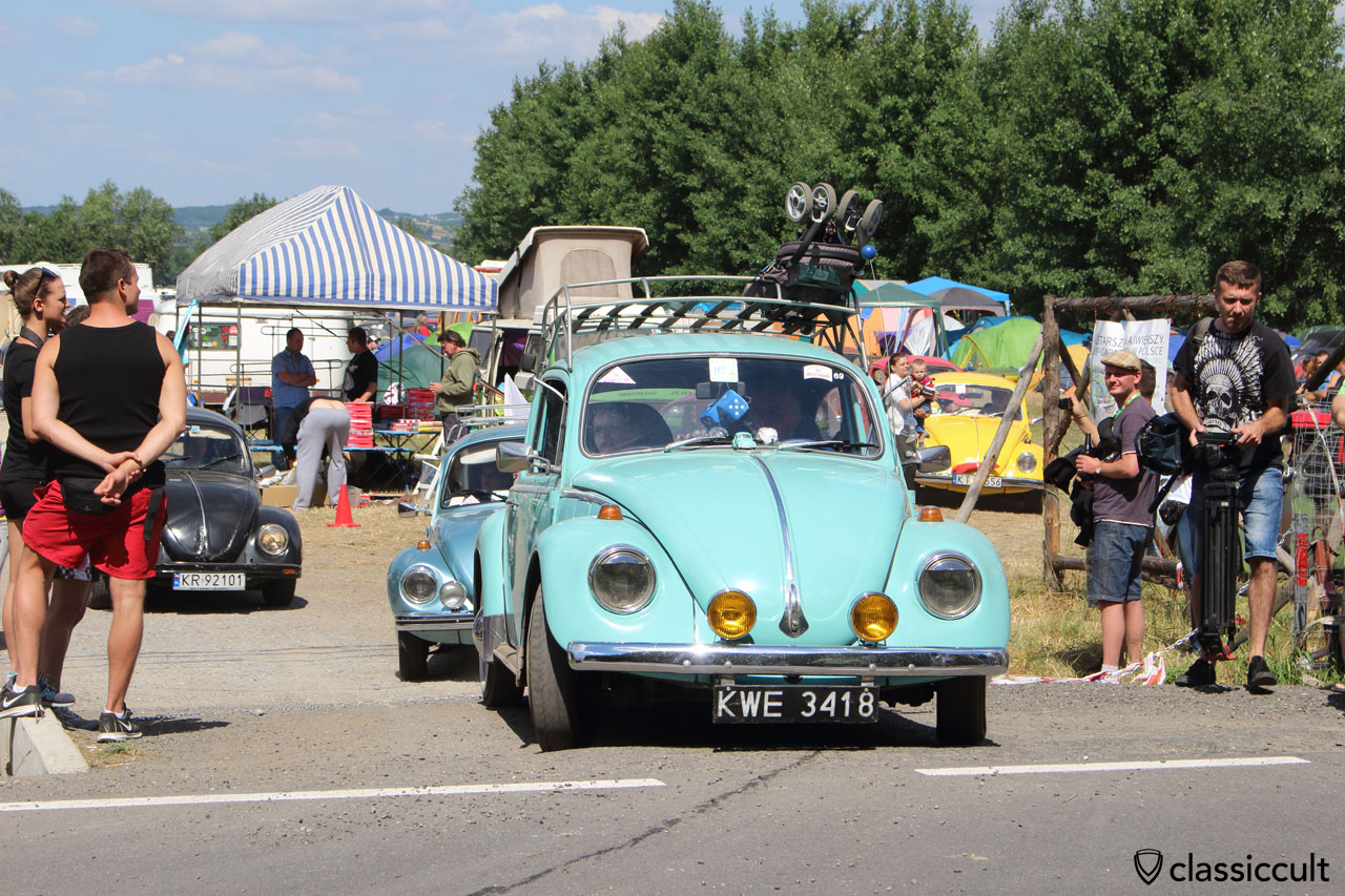 blue VW Bug drives off to Wawel Castle