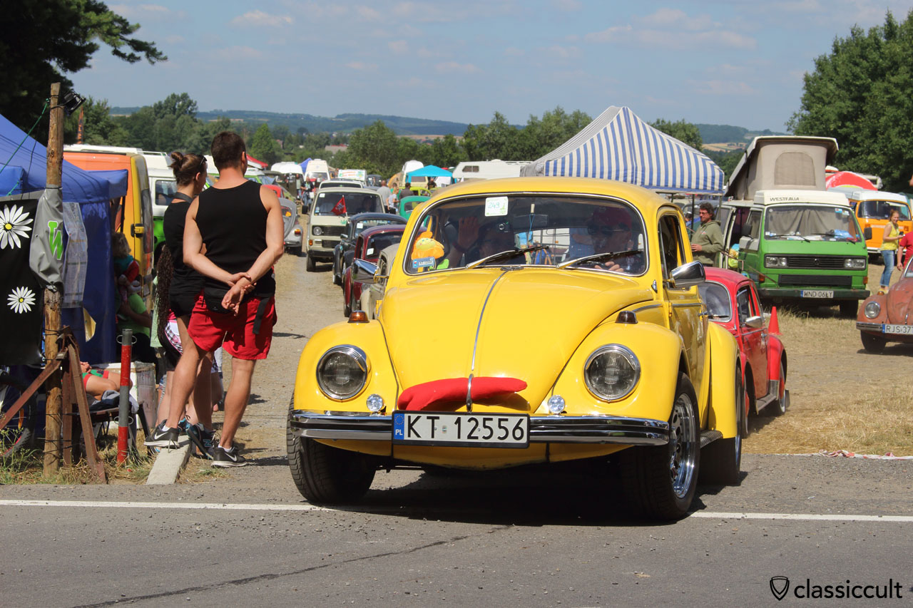 yellow VW Bug drives off to Wawel Castle