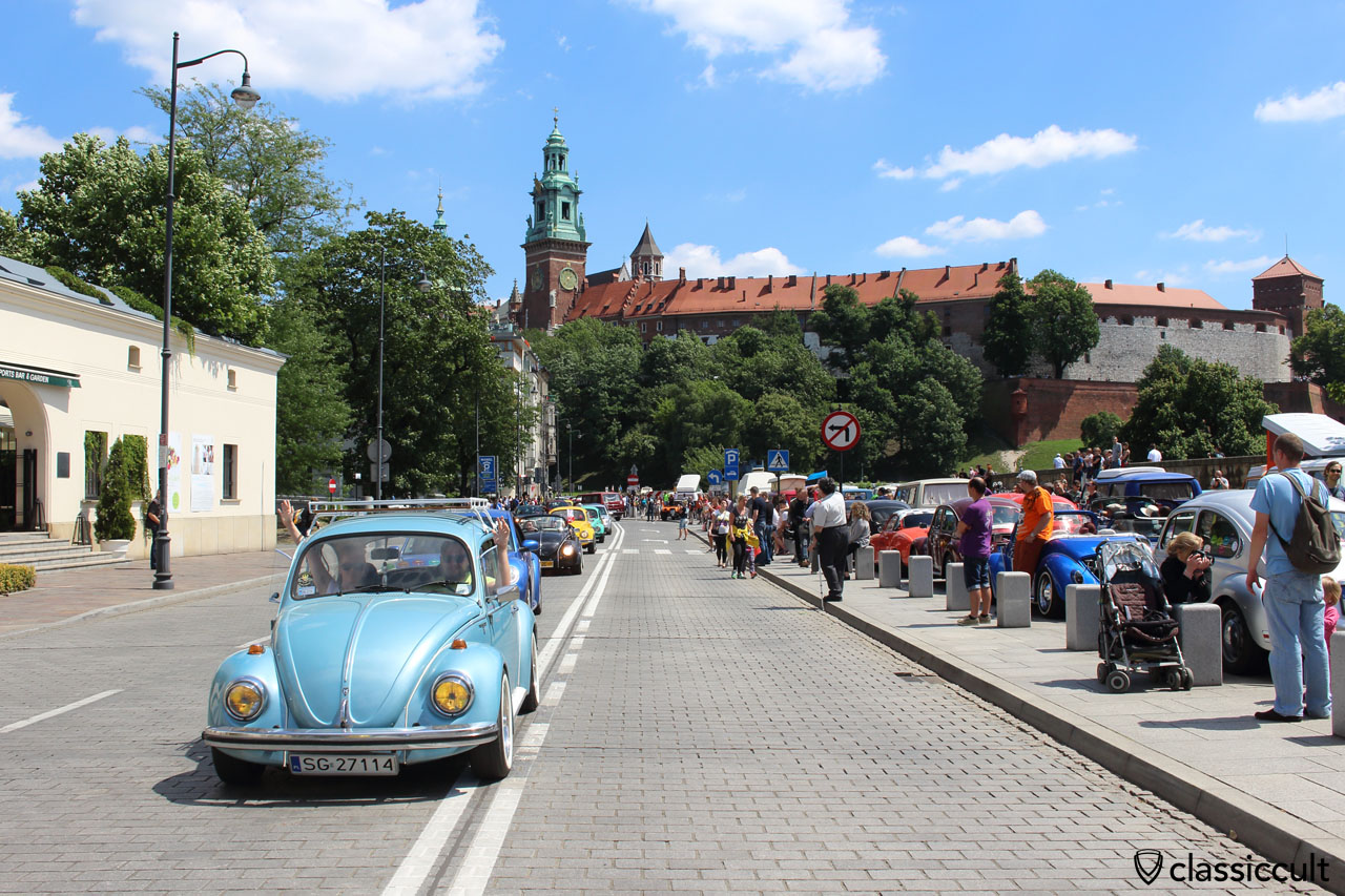 VW Beetles and in the background the Wawel Castle