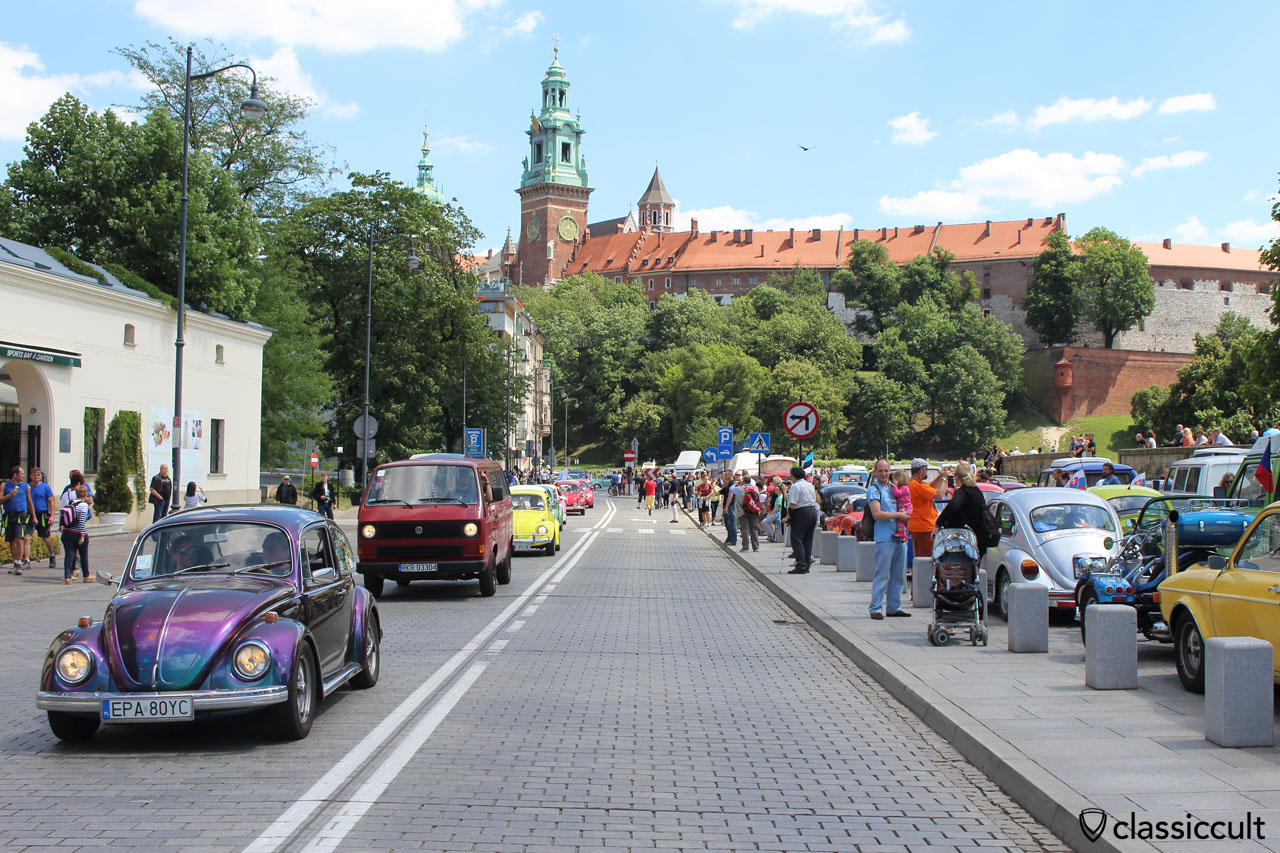 classic VWs and in the background the Wawel Castle