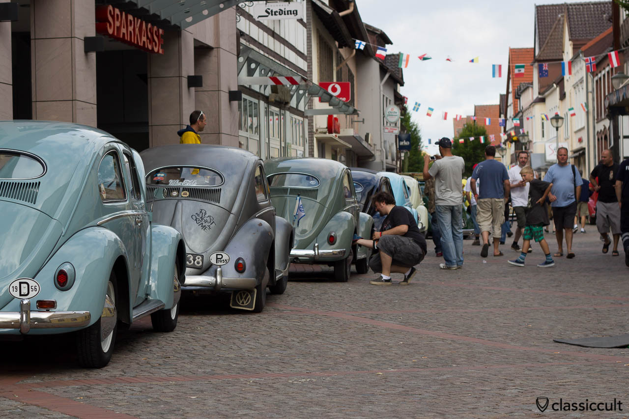 VW Oval Beetles, the third Oval is from France and the owner is waxing the old first color, 6eme Meeting International VW Vintage de Hessisch Oldendorf 2013