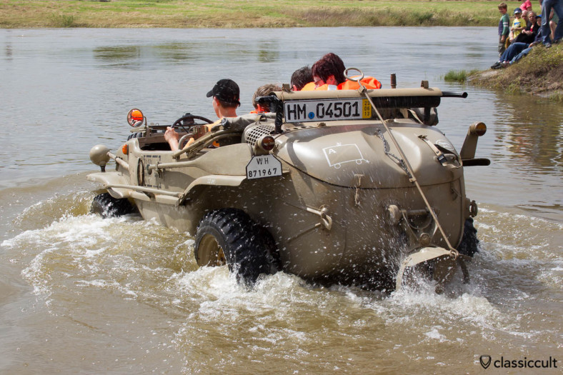 VW 166 Schwimmwagen from Germany drives in the Weser River at Grossenwieden crossing near Hessisch Oldendorf, June 22, 2013