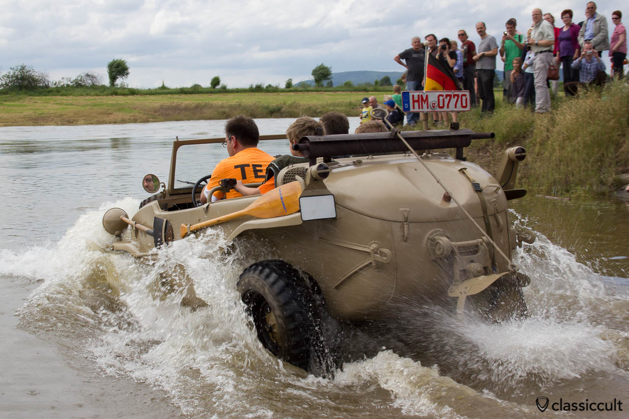 VW Schwimmwagen from Germany drives in the Weser River at Grossenwieden crossing near Hessisch Oldendorf, June 22, 2013