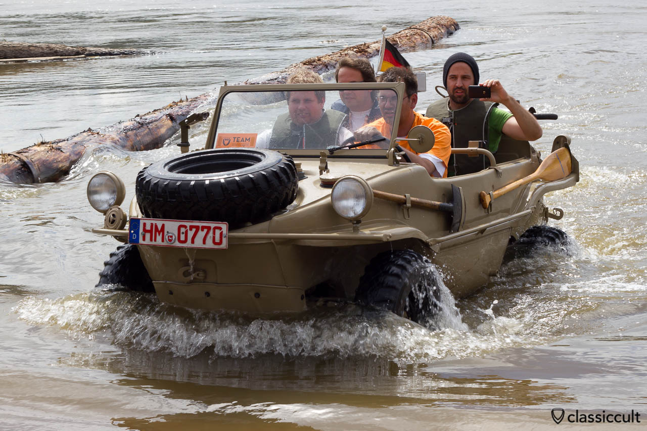 German VW Schwimmwagen comes out of the Weser River at Grossenwieden, June 22, 2013