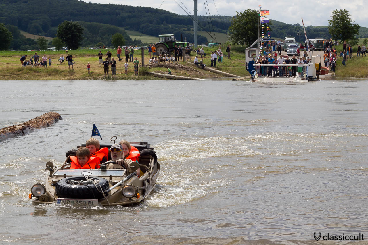 VW 166 Schwimmwagen from Austria cruising in Weser River, June 22, 2013, Hessisch Oldendorf