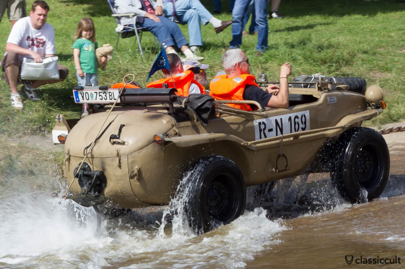 VW 166 Schwimmwagen from Austria comes out of the Weser River at Grossenwieden near Hessisch Oldendorf, June 22, 2013, 16:49 p.m.