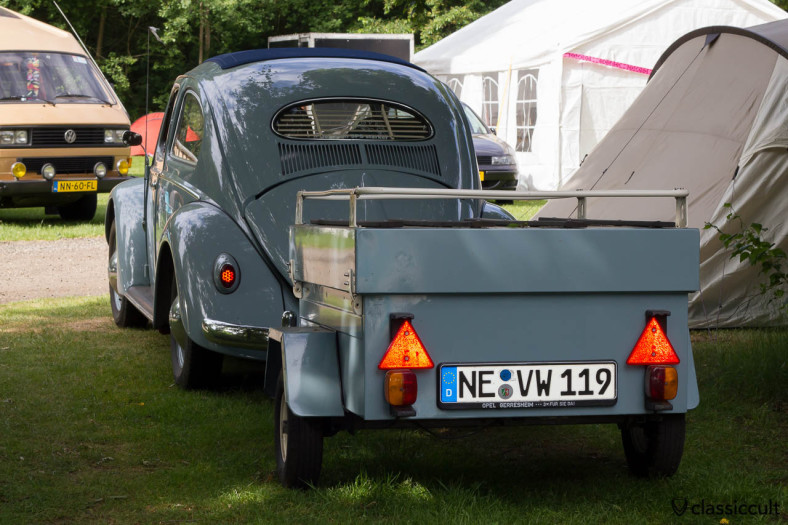 German VW Ragtop Oval Bug with camping trailer. Please change the license plate holder on the trailer!