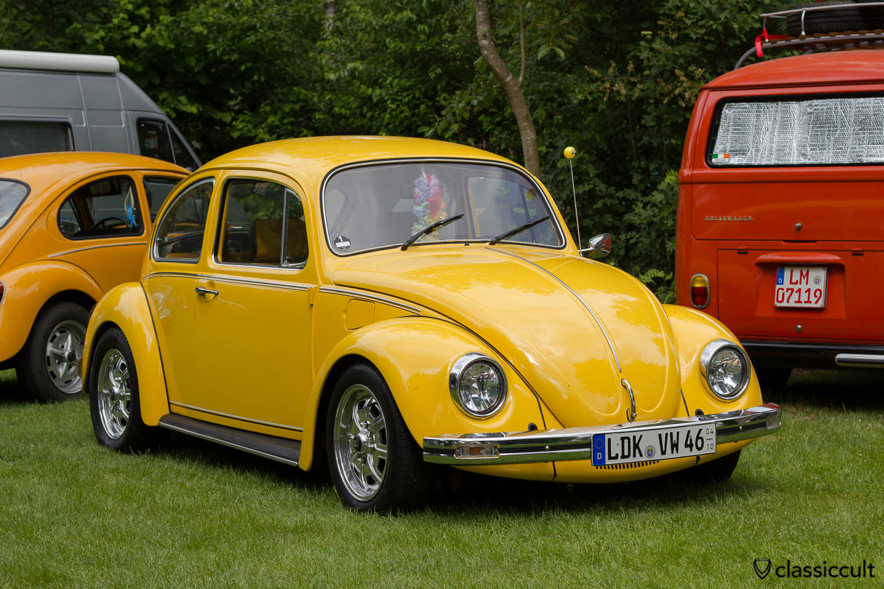 slammed yellow VW Bug with Wolfsburg wheels