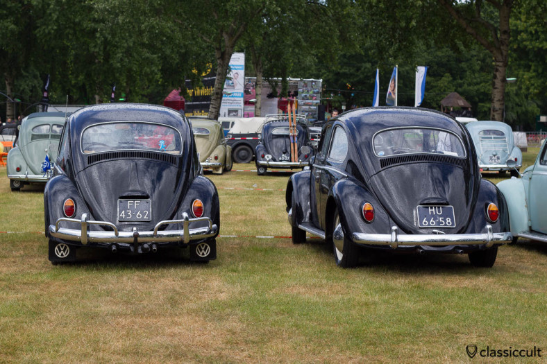 backside of an 1958 and 1962 VW Beetle in black