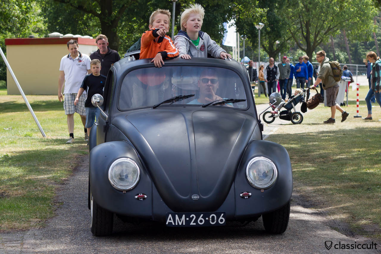 VW Split Ragtop Bug with kids having fun