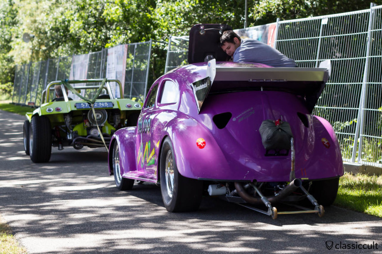 VW hot rod Beetle getting towed by a VW Buggy at IKW Internationaal Kever Weekend Wanroij