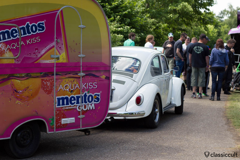VW Beetle with mentos advertisement caravan