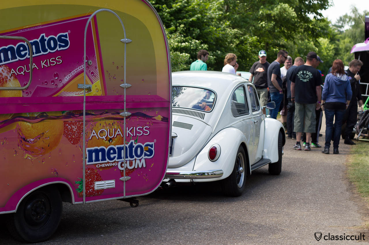 VW Beetle with mentos advertisement caravan