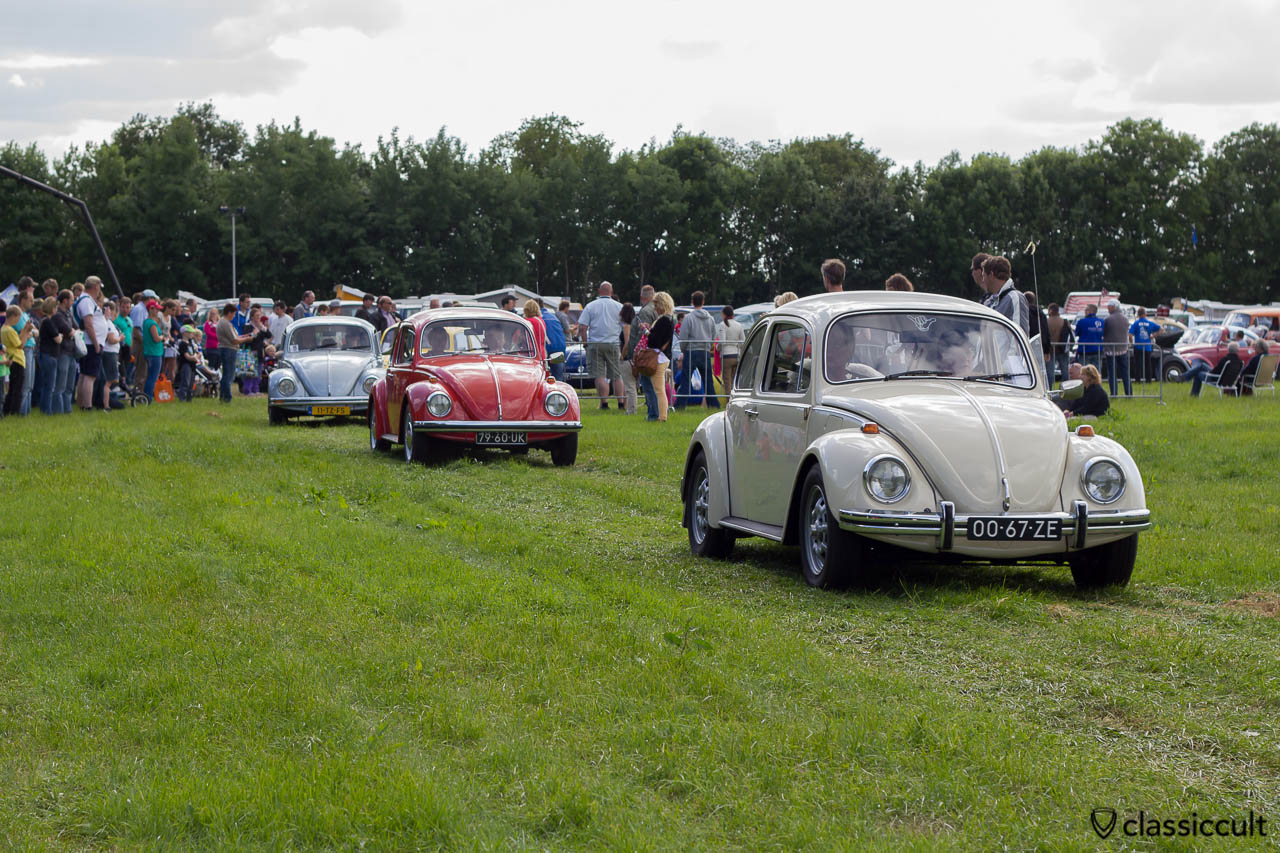 three Volkswagen Beetles leaving the aircooled parking