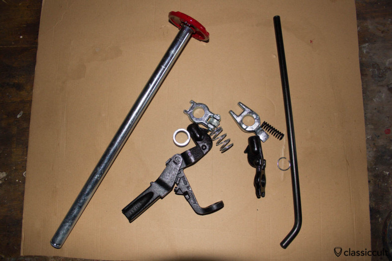 Restored parts of the VW Bug jack after resto zinc plated in black and silver. The head of the jack is painted in ruby but the original color is blue. This was the first part which I had assembled.