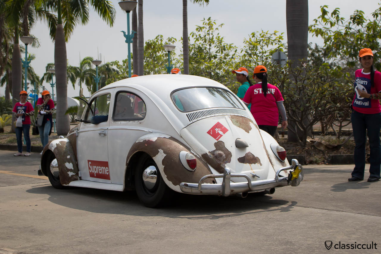 VW Bug with rust and SUPREME advertisement