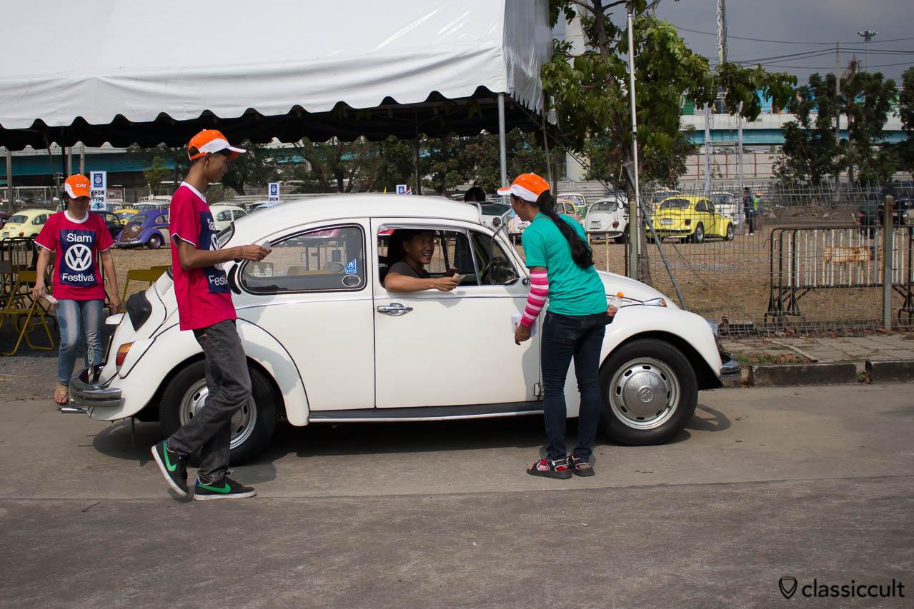 white VW Bug with sun visor and Staff