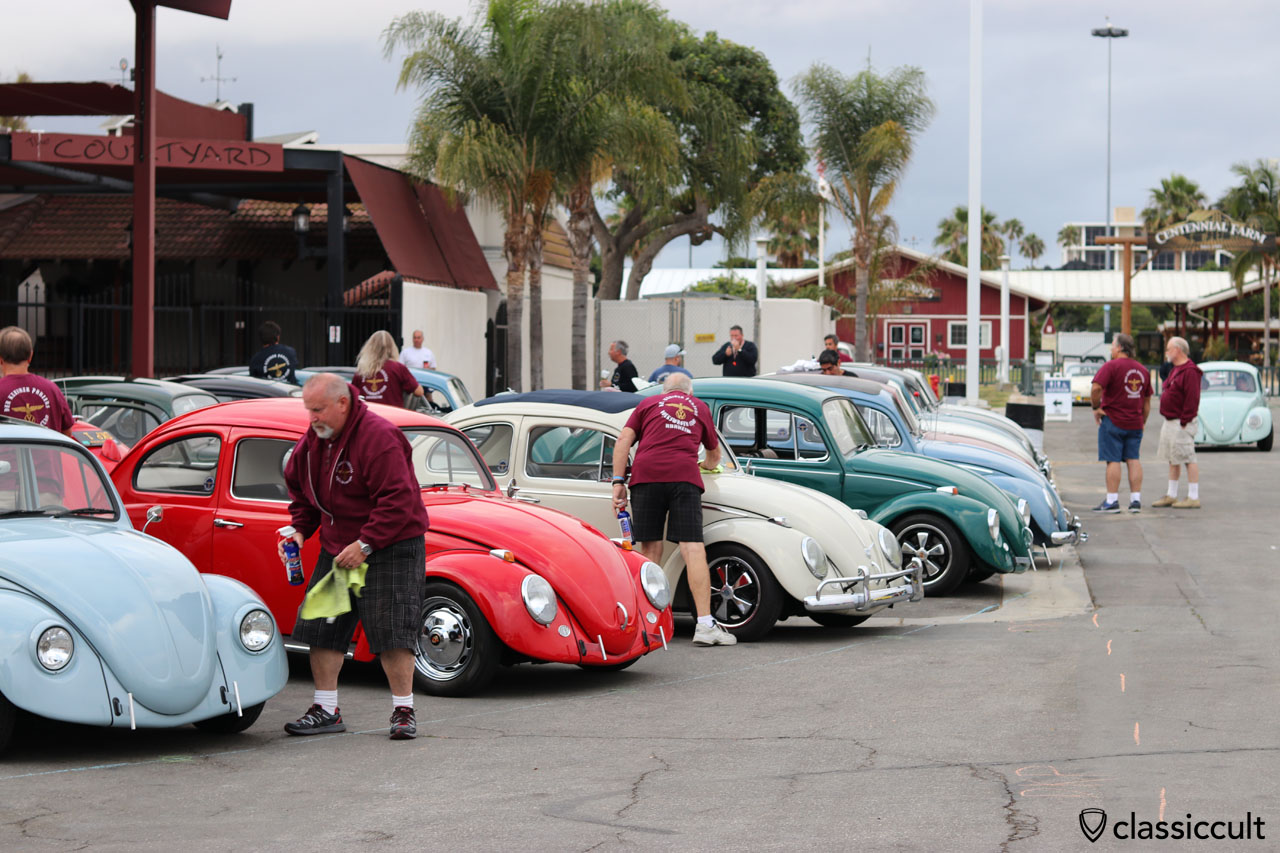 Busy VW Fans, after the Cal-Look VW Beetles arrived at the Show area, the Show cars were polished by owner, 6:31 a.m., The Classic 2016, California, USA