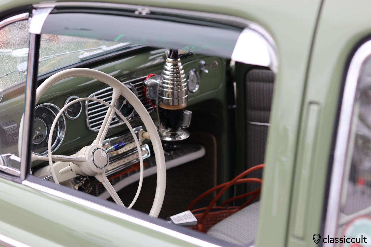 VW Oval dash with accessories like 3-Spoke Petri Steering Wheel, Gene Berg shifter, coffee machine, Blaupunkt short wave, blue indicator switch