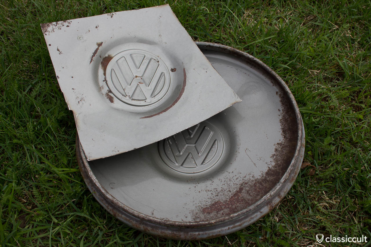 Unrestored VW 1200A 1965 1966 Hubcap in L328 steel grey. The hupcap was mounted on my 1200A Standard when I bought the beetle. I had to cut out the middle of one hubcap to get the hubcap under an electronic paint reader. Unfortunate it was not possible to get the original color code with an electronic paint reader, because the hubcap inside is irregularly painted.