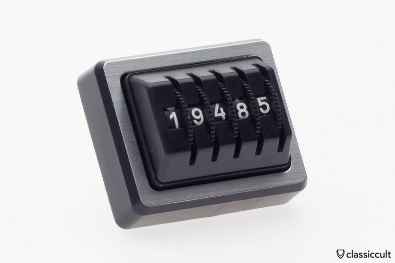 Made in Germany kilometer dash trip counter in black / silver with a sticker on the rear side.