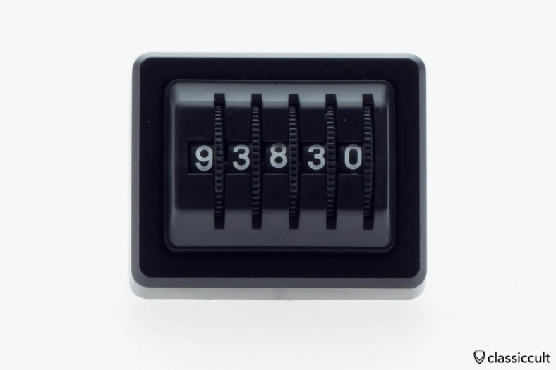 Made in Germany kilometer dash trip counter in black with a sticker on the rear side.