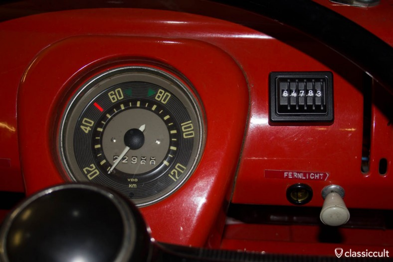 VW T1 Bus dashboard with a made in Germany kilometer trip counter in black.