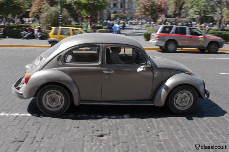 Volkswagen Bug driving around Plaza de Armas of Arequipa, Peru, May 8, 2013