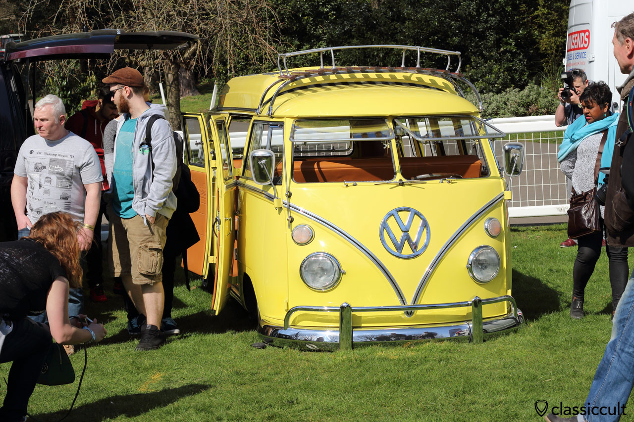 low VW Split Camper in yellow