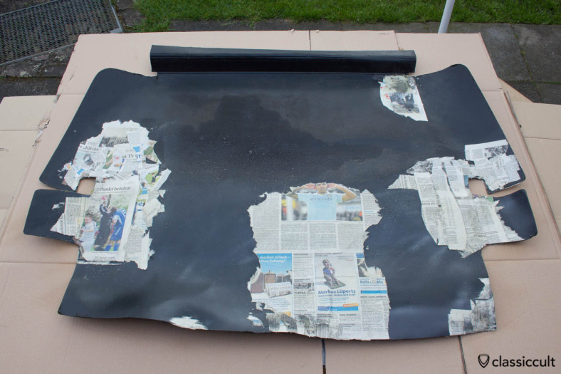 VW 1200A Hardboard trunk liner resto step 1. I put a few layers of newspaper peace's with spray adhesive at the cracks of both sides of the hardboard trunk liner.