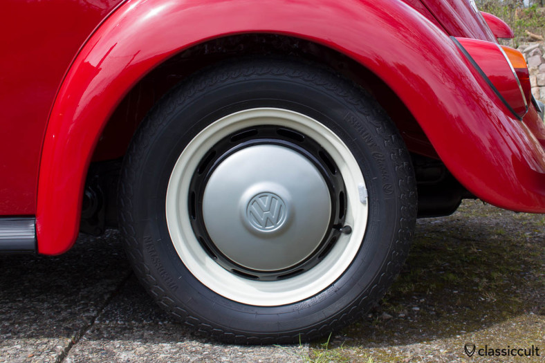 VW 1200A hubcaps are steel grey L328. The wheels are pearl white L87 and black L41.