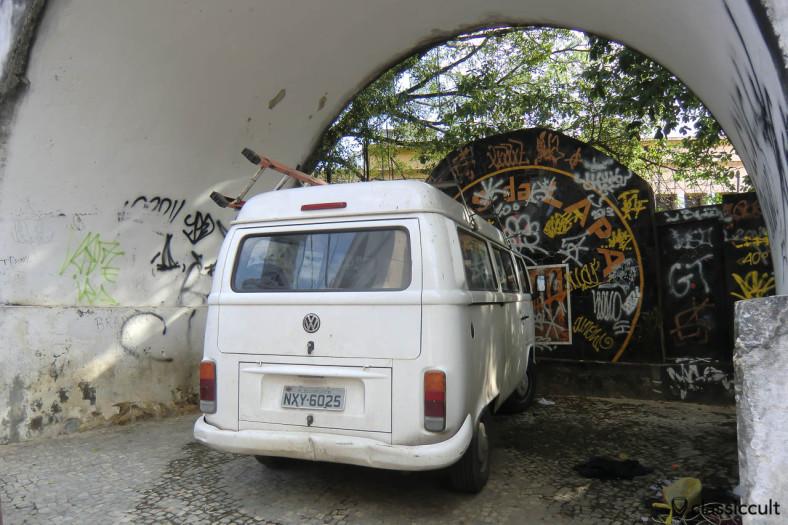 VW Bay Bus parking under the Arcos da Lapa Aqueduct, Rio, Brazil, May 23, 2013
