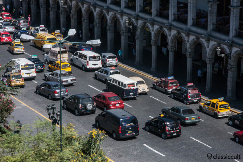 VW Bay Window Bus and Beetle at Plaza de Armas Arequipa, Peru, May 8, 2013. The picture was taken from the top of the Basilica Catedral Arequipa.