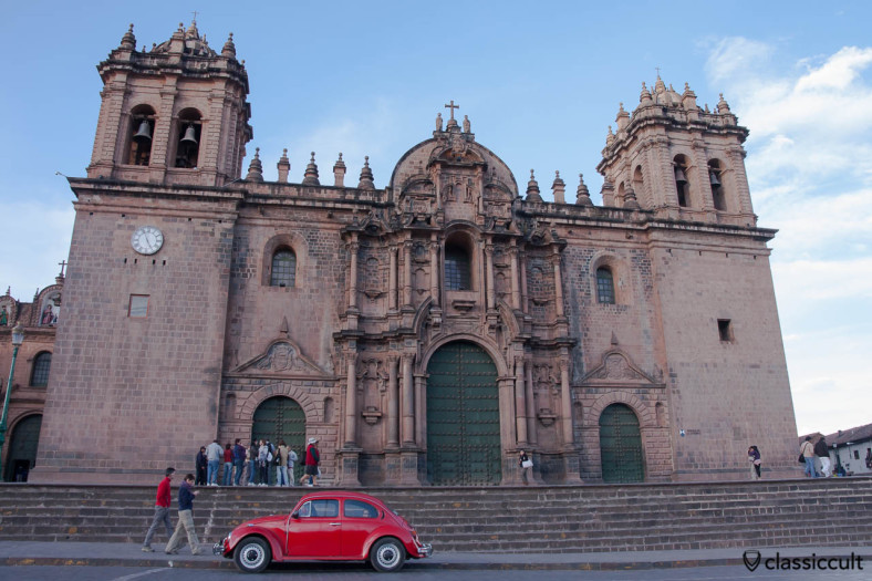 VW Beetle in front of the Cathedral of Santo Domingo, Cusco, Peru, May 11, 2013