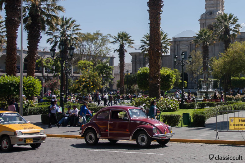 VW Beetle and the Plaza de Armas of Arequipa, Peru, May 8, 2013