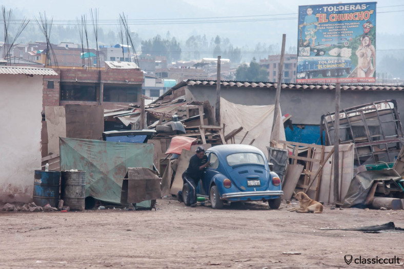 Peruvian pushes his VW Beetle seen from Cuzco to Puno train, Peru, May 15, 2013.