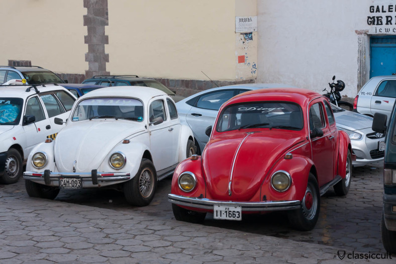 VW Beetles at the Entrance to Museo Galeria Merida, Cusco, Peru, May 11, 2013. 5 hours ago, the red Beetle was parking in front of Iglesia de San Blas.